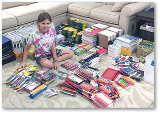 Page 15 student collecting school supplies.tif